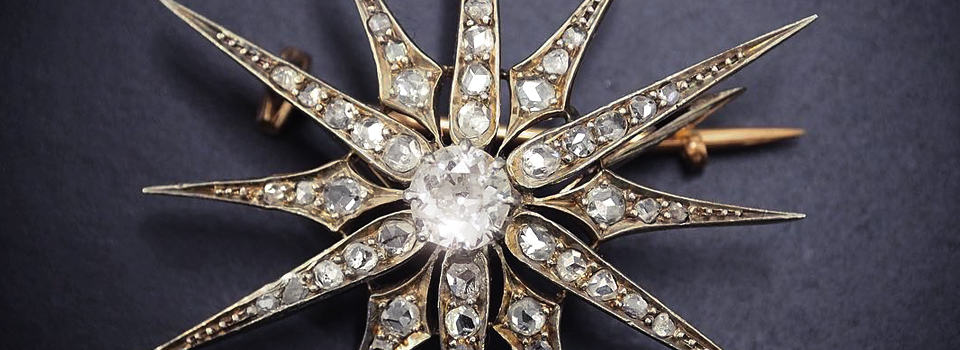 Sternförmige antike Brosche mit Diamanten